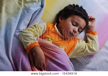 Child asleep, in bed, dark