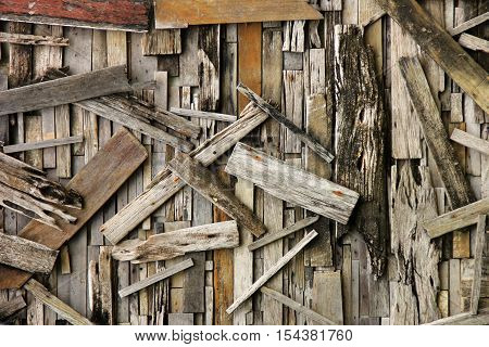 Wall recycled from scrap wood boards for background