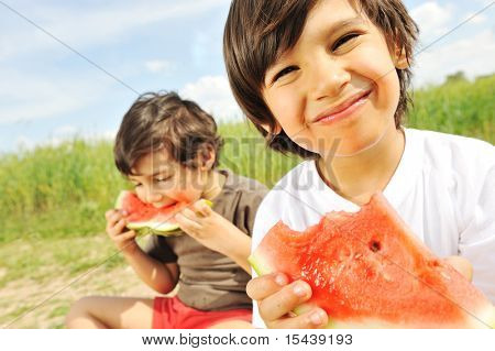 Eating watermelon outside