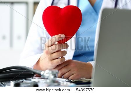 Female Medicine Doctor Hands Holding Red Toy Heart