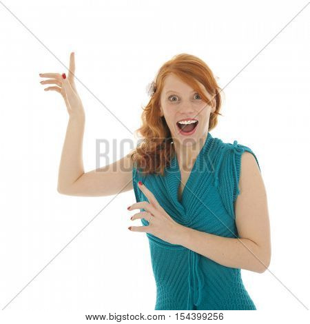 Woman pointing enthusiastic above isolated over white background