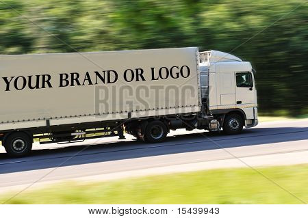 Big truck photographed from back side, no logo except great place for your logo or name of the brand