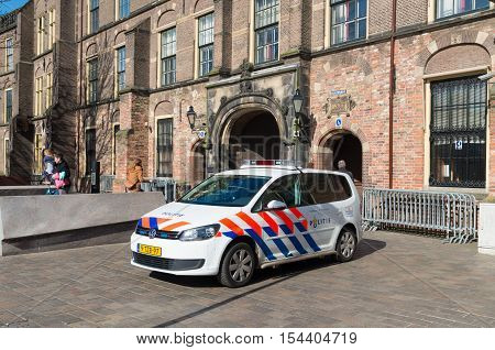 THE HAGUE NETHERLANDS - MARCH 28 2016: Police car in front of the Binnenhof the settlement of the dutch parliament