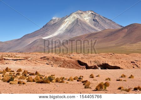 Ollague or Ullawi is a massive andesite stratovolcano in the Andes on the border between Bolivia and northern Chile.