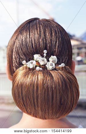 Back view of a female blond head with a braided bridesmaid