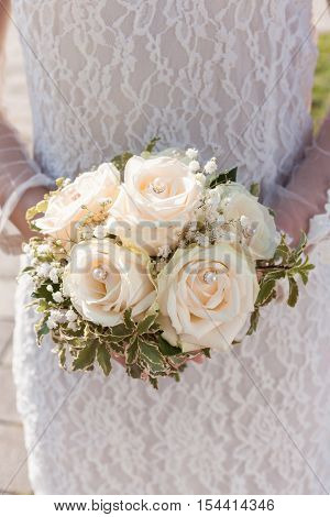 Bridal bouquet white roses with Pearl and leaf green
