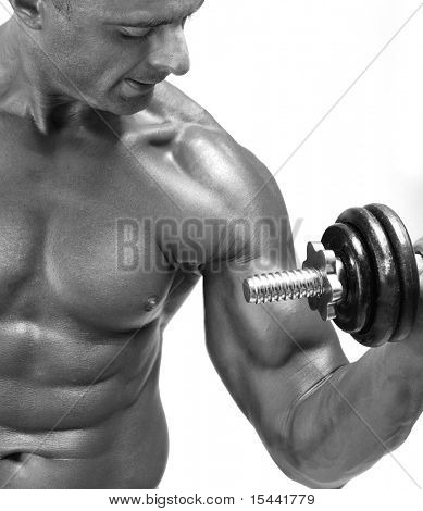 Bodybuilder strong as a rock exercising, isolated man