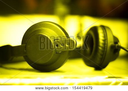 Professional sound recording audio studio closed headphones to monitor recording music musical instruments voices singing dubbing and voiceovers.