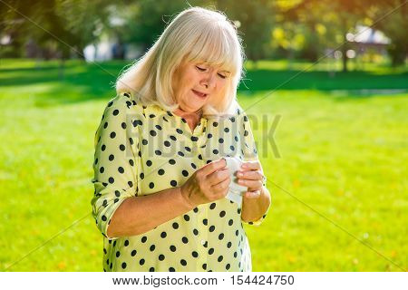 Elderly woman is crying. Sad lady with a handkerchief. It's all over. Hard lesson learned.