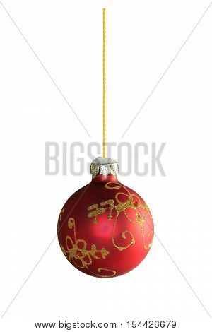 red christmas ball with golden ornamentation on a white background isolated