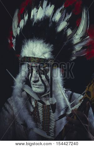 Apache, American Indian chief with feather headdress and traditional war ax