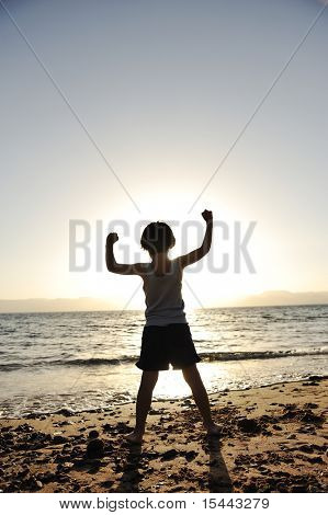Kid on sea, silhouette