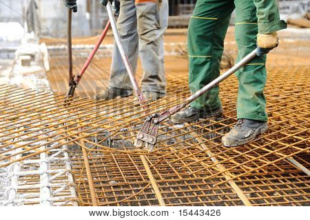 A construction worker hooking up iron beams