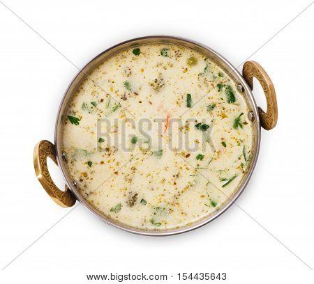 Vegan and vegetarian dish, cold summer yoghurt raita soup bowl. Indian cuisine, yoghurt, cucumber and dill meal isolated on white background. Healthy eastern local cuisine restaurant food top view