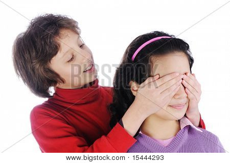 Girl covering a girls eyes to see if she can guess who is behind her