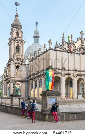 Addis Ababa Ethiopia - January 14 2016: Joung local people in front of the Cathedral of the Holy Trinity