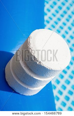 Chlorine Pellets On The Edge Of An Inflatable Pool