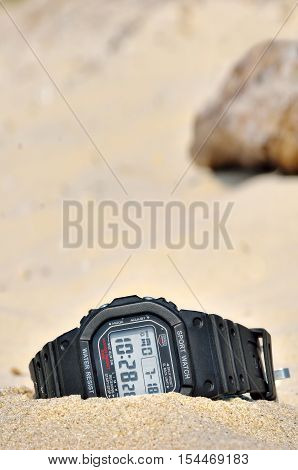 Sports Waterproof Watch Forgotten In The Sand. Accessories For Extreme Relaxation.