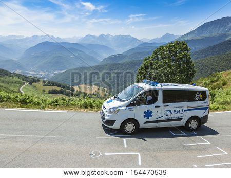 Col D'AspinFrance- July 15 2015: The offiical ambulance driving on the road to Col D'Aspin in Pyrenees Mountains during the stage 11 of Le Tour de France 2015.