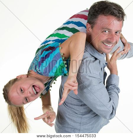Dad Playing With His Happy Pre Teen Daughter, Holding Her Upside Down,