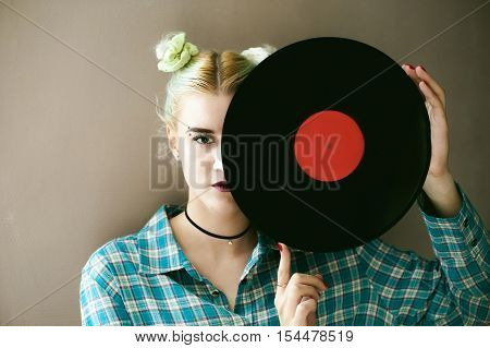 A Woman With The Disc. Young Beautiful Hipster Girl With Old Vintage Vinyl Record In His Hands. She