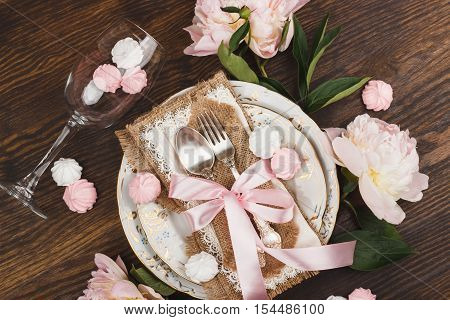 Light Pink Peonies And Tableware On The Wooden Table