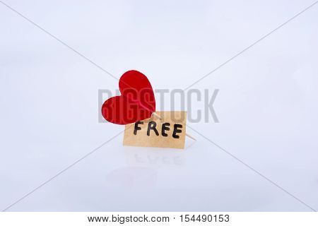 Red heart color icon and the word FREE