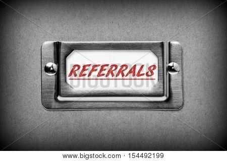 The word Referrals in red text on a drawer label as part of your filing system for new business and customer sales leads