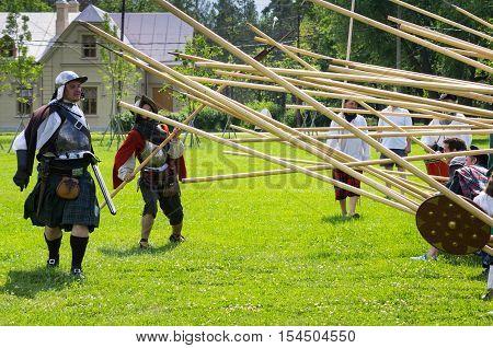 PETERHOF- JULY 07: Reconstruction of knightly fight in Peterhof on July 07 2013 SAINT-PETERSBURG RUSSIA. The festival