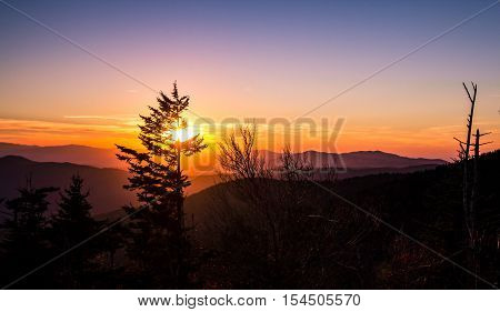 Smoky Mountain Sunset. Smoky Mountain Sunset. Sunset from Clingmans Dome overlook of the Great Smoky Mountains National Park. The Smokies are America's most visited national park surpassing even Yellowstone and Yosemite.