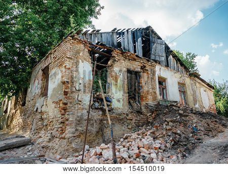 demolition of the old one-story brick house
