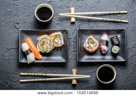 Sushi For Two Served In A Black Ceramic