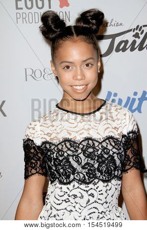 Asia Monet Ray arrives at the