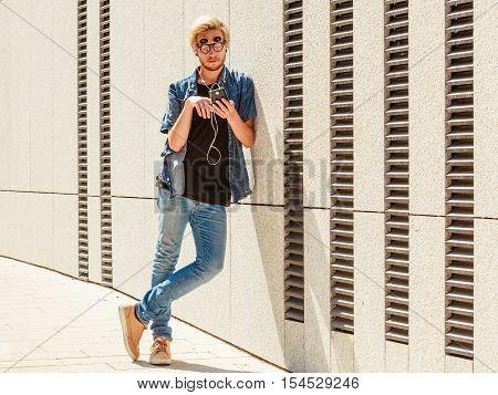Hipster Man Listening Music Through Earphones
