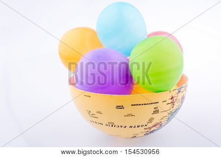 Colorful balloons in a bawl on a white background