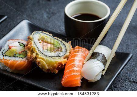 Closeup Of Sushi Served In The Dark Ceramics