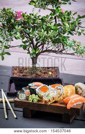 Sushi served and ready to eat on old wooden table