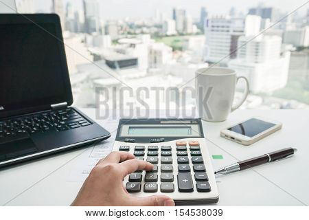 close up women accountant use calculate in office