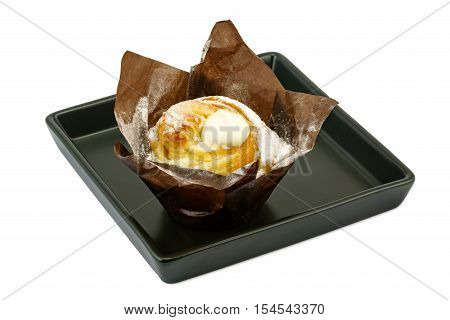 Cruffin creme brulee in black plate on white background