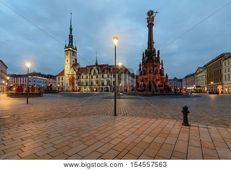 Town hall and Holy Trinity Column in the main square of the old town of Olomouc Czech Republic in the evening.