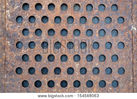 old rusty metal grater fragment background and texture