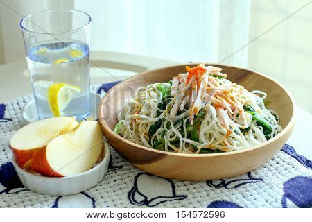 Healthy meal with Japanese cold noodle, apple and a glass of water