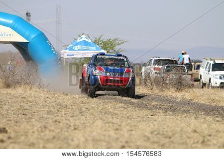 Speeding Blue And Red Toyota Nissan Single Cab Rally Car At Start Of Race