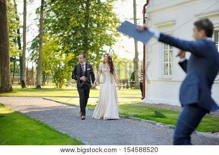 Bride And Groom Being Greeted By Their Guests