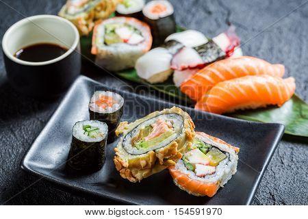 Fresh Sushi On The Black Ceramic Dish