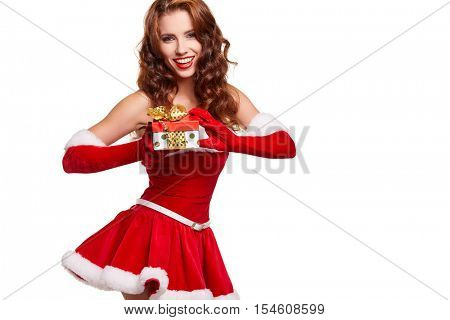 sexy new year woman or girl with long brunette hair and pretty face in red christmas santa claus holiday dress