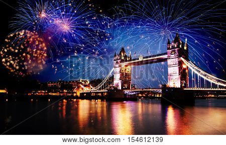 new year in the city - Tower bridge with fireworks, London, Uk