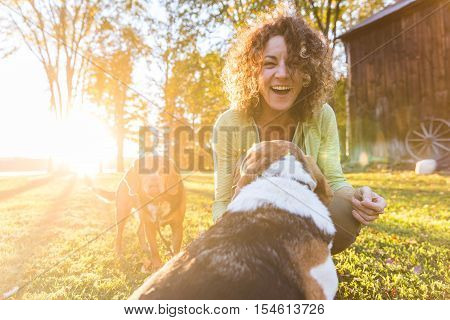 Adult Woman Playing With Her Dogs At Park