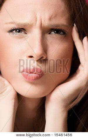 young woman portrait closeup, studio shot