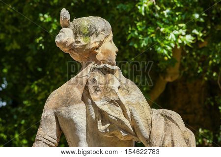 Paris France - Jul 14 2014: Old statue in Champs elysees garden in Paris France